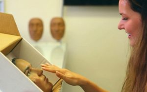 A lady touching her new fake nose after 3d scanning her old one and reverse engineering using geomagic software