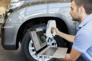 Artec Eva being used to scan a car wheel arch