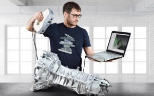 Artec Eva handheld 3d scanner used on automotive gearbox casting